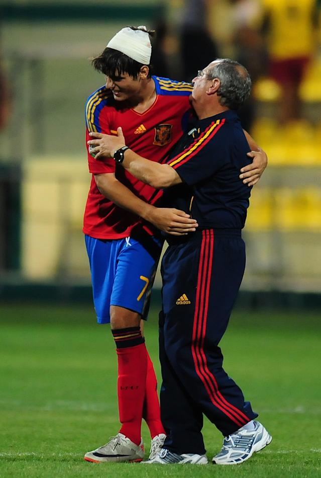 Alvaro Morata (L) of Spain celebrates with coach Paul Doolin (R) at the end of match against Ireland during their UEFA European Under-19 Championship football match, near the village of Chiajna village, outside of Bucharest, on July 29, 2011. AFP PHOTO/DANIEL MIHAILESCU (Photo credit should read DANIEL MIHAILESCU/AFP/Getty Images)