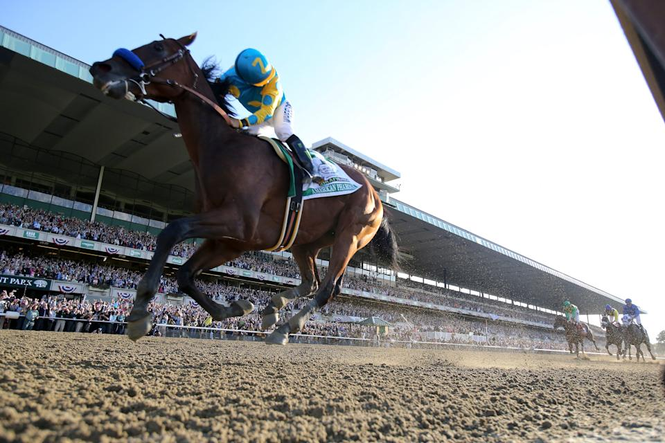 Jockey Victor Espinoza looks back at the competition as American Pharoah wins the Belmont Stakes and the first Triple Crown in 38 years on June 6, 2015.