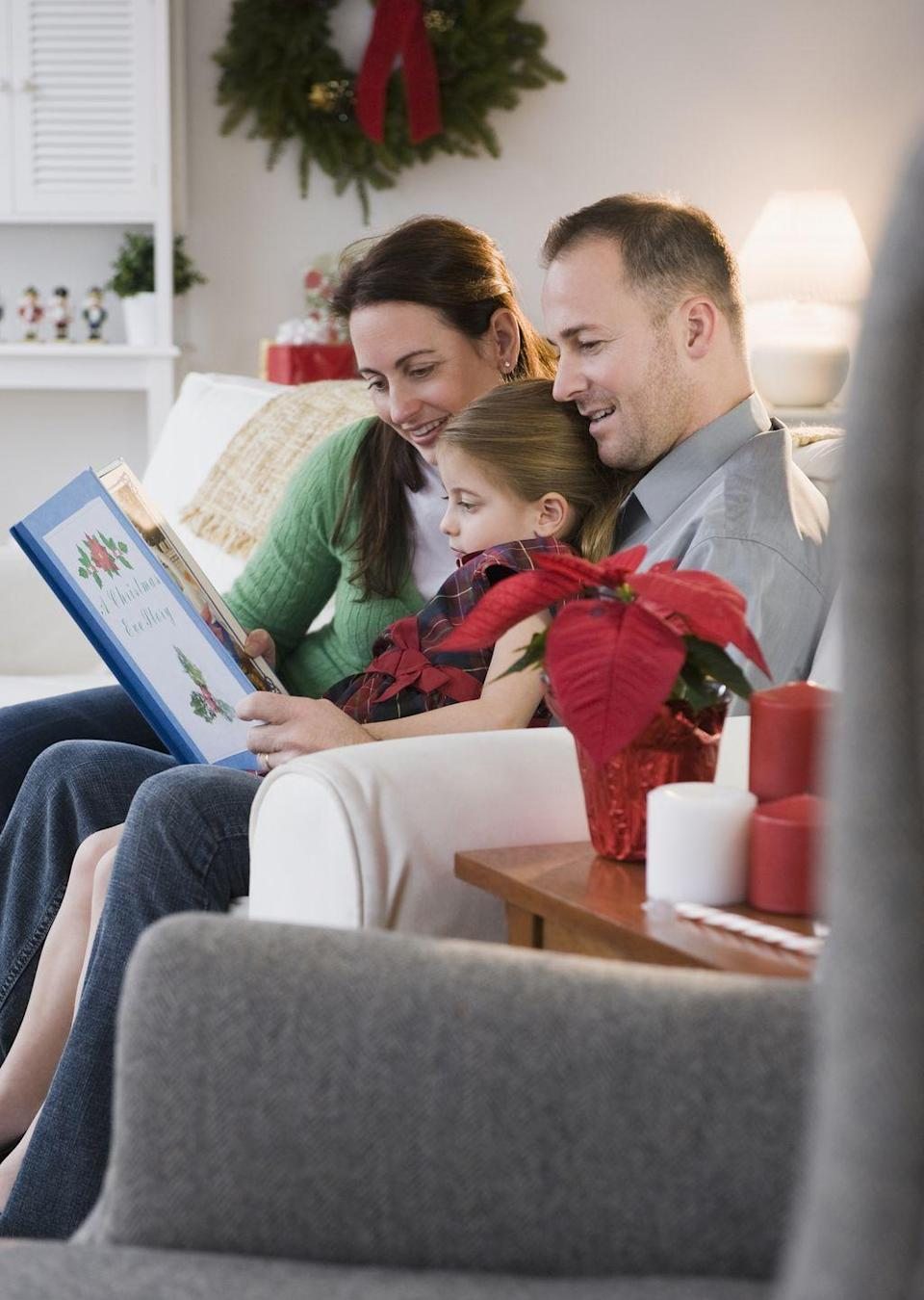 """<p>If you're pretending, it'll probably come across in the final image. """"If you use a <a href=""""https://www.goodhousekeeping.com/holidays/christmas-ideas/g23743657/christmas-books/"""" rel=""""nofollow noopener"""" target=""""_blank"""" data-ylk=""""slk:Christmas book"""" class=""""link rapid-noclick-resp"""">Christmas book</a>, for example, have mom and dad hold the book while the kids are looking at it,"""" says Hyde. """"It works if it's a genuine moment. If you're really reading it — and you say something like, 'Can you find the mouse on this page?' — then the kids will actually enjoy it, and the photo will look more natural.""""</p>"""