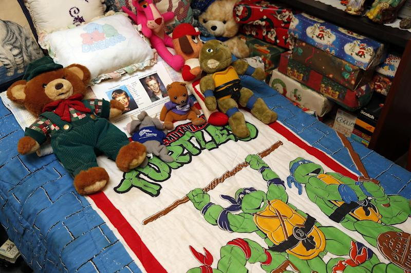 This photo taken April 29, 2014 shows the bedroom of Victor Shoemaker Jr., as it remains basically unchanged including stuffed animals on the bed and Christmas presents still wrapped, in Leesburg, Va. Twenty years after Victor Dwight Shoemaker Jr., vanished while playing with two cousins along a West Virginia mountainside, his parents hold the belief that their only child is still alive. The boy known as J.R. had been in the woods behind his grandfather's mobile home in Hampshire County when two cousins emerged without him on May 1, 1994. No trace of him was ever found. (AP Photo/Alex Brandon)