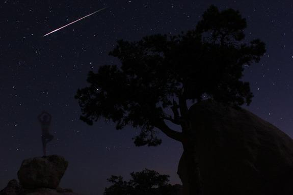 Night sky watcher Natalie Duran took this photo of the Perseid meteor shower from Joshua Tree National Park on August 12, 2012. The photographer can be seen standing on a rock in the background.