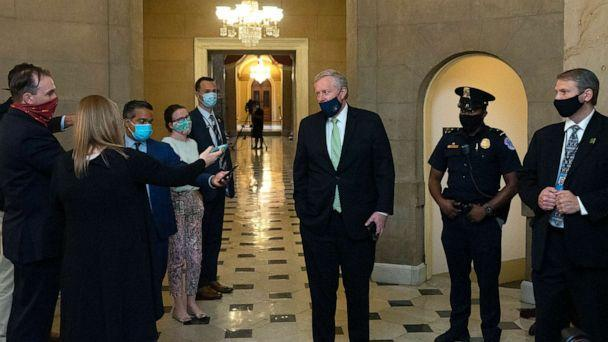 PHOTO: White House Chief of Staff Mark Meadows (C) speaks to members of the media as he arrives for a meeting at the office of Speaker of the House Nancy Pelosi on Aug. 6, 2020, in Washington, DC. (Stefani Reynolds/Getty Images)