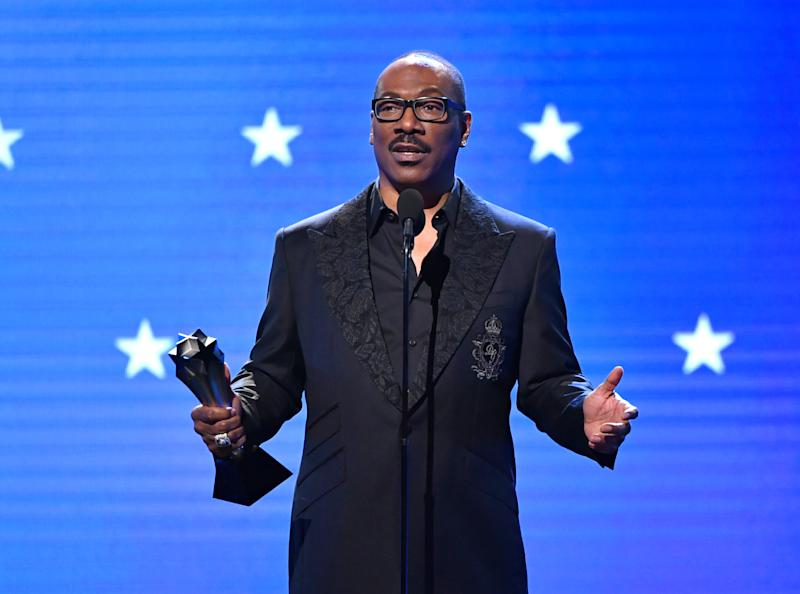 SANTA MONICA, CALIFORNIA - JANUARY 12: Eddie Murphy accepts the Lifetime Achievement Award onstage during the 25th Annual Critics' Choice Awards at Barker Hangar on January 12, 2020 in Santa Monica, California. (Photo by Amy Sussman/Getty Images)