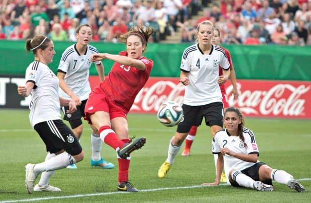 Canadian international Lindsay Agnew, featured taking a shot in this file photo from the 2015 Women's World Cup, announced on Sunday via social media that she has been sidelined by a broken foot suffered during training with the North Carolina Courage.   (Jason Franson/The Canadian Press - image credit)