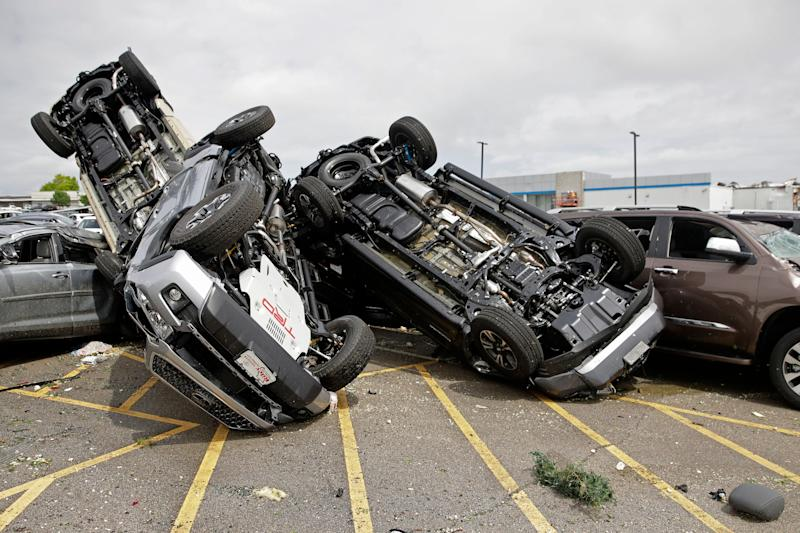 New Toyotas are piled up at a dealership in Jefferson City, Mo., Thursday, May 23, 2019 after a tornado tore though Jefferson City late Wednesday. (AP Photo/Charlie Riedel)