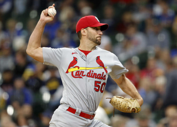 St. Louis Cardinals starting pitcher Adam Wainwright strikes out Milwaukee Brewers' Luis Urias for his career 2,000th strikeout during the fourth inning of a baseball game Thursday, Sept. 23, 2021, in Milwaukee. (AP Photo/Jeffrey Phelps)