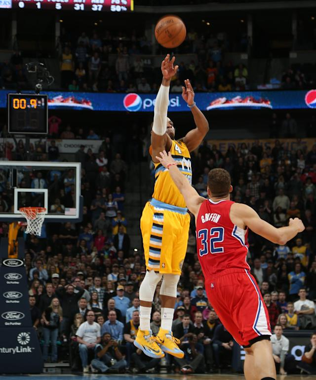 Denver Nuggets guard Randy Foye, back, shoots a 3-point basket over Los Angeles Clippers forward Blake Griffin with nine-tenths of a second remaining in the fourth quarter of the Nuggets' 116-115 victory in an NBA basketball game in Denver, Monday, Feb. 3, 2014. (AP Photo/David Zalubowski)