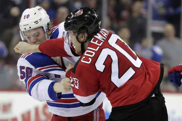 New York Rangers center Lias Andersson (50), of Sweden, fights with New Jersey Devils center Blake Coleman (20) during the second period of an NHL hockey game, Monday, April 1, 2019, in Newark, N.J. (AP Photo/Julio Cortez)
