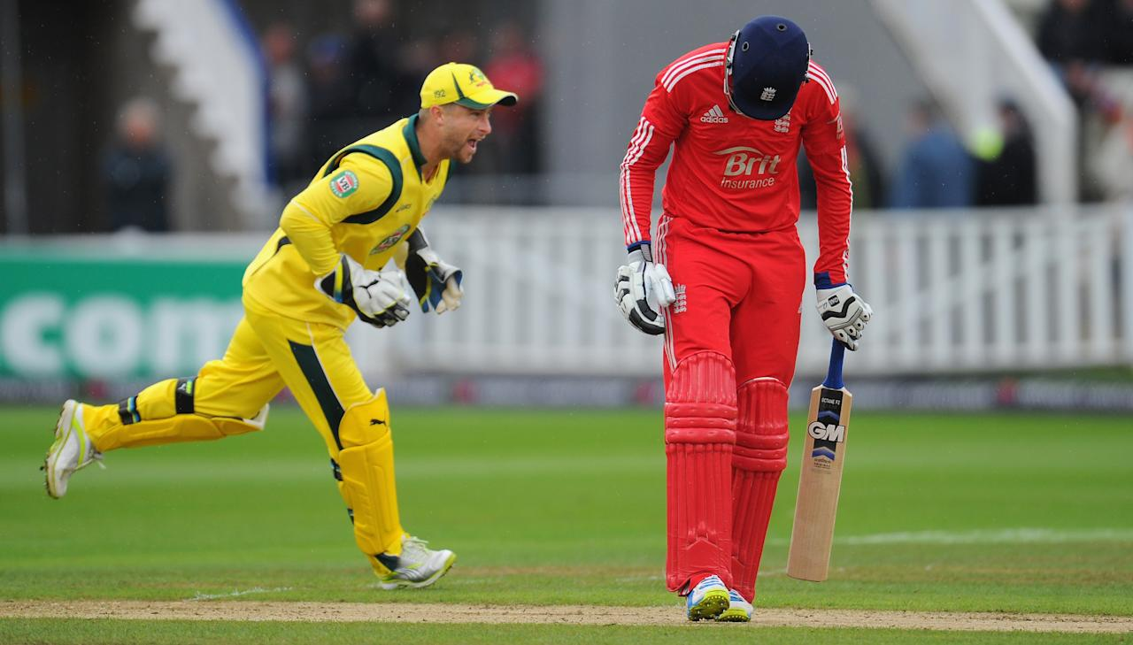 BIRMINGHAM, ENGLAND - SEPTEMBER 11:  England batsman Joe Root leaves the field after being dismissed as the Australian wicketkeeper Matthew Wade celebrates during the 3rd Natwest Series One Day International between England and Australia at Edgbaston on September 11, 2013 in Birmingham, England.  (Photo by Stu Forster/Getty Images)