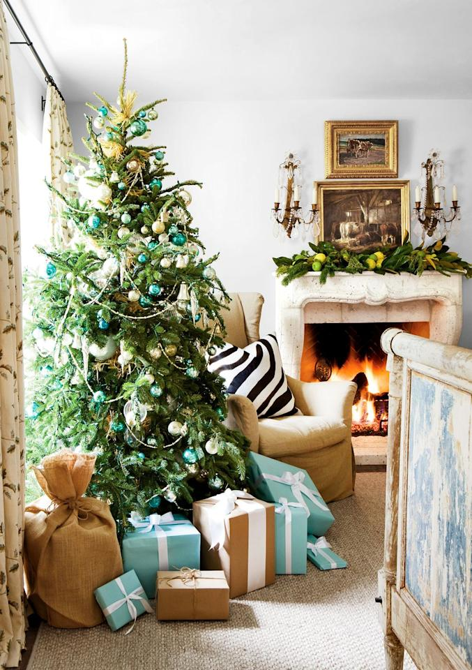 <p>Coordinate your gift wrapping to complement the color scheme in your living room. Use the same techniques for your ornaments for a cohesive whole. </p>