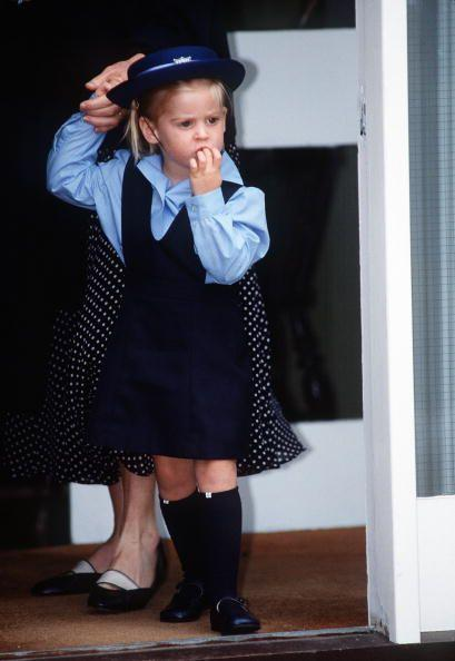 <p>Princess Beatrice, who is Prince Andrew's oldest daughter, attends her first day of school in an adorable tunic and matching cap. </p>