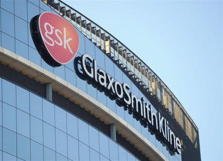 A GlaxoSmithKline logo is seen outside one of its buildings in west London, ahead of company results