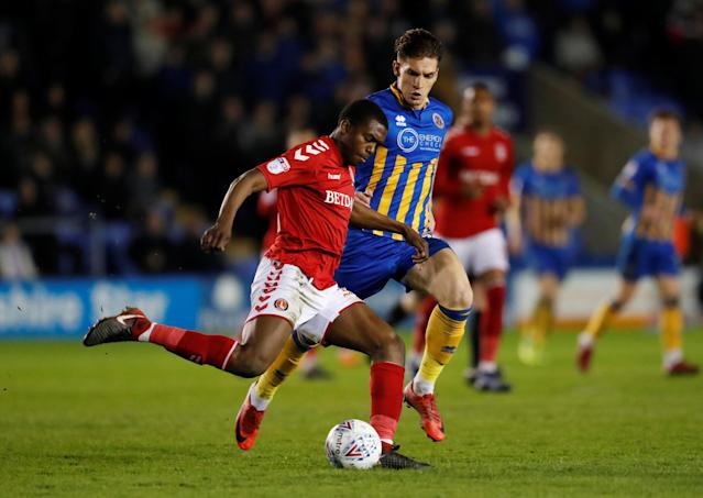 "Soccer Football - League One - Shrewsbury Town vs Charlton Athletic - Montgomery Waters Meadow, Shrewsbury, Britain - April 17, 2018 Charlton's Anfernee Dijksteel in action with Shrewsbury Town's Sam Jones Action Images/Andrew Boyers EDITORIAL USE ONLY. No use with unauthorized audio, video, data, fixture lists, club/league logos or ""live"" services. Online in-match use limited to 75 images, no video emulation. No use in betting, games or single club/league/player publications. Please contact your account representative for further details."