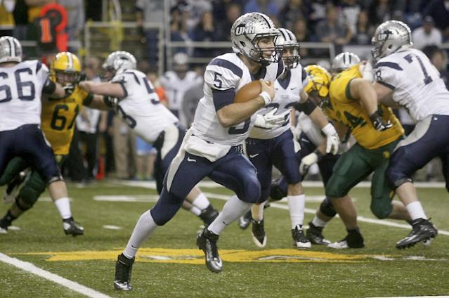 New Hampshire quarterback Sean Goldrich (5) finds running room against North Dakota State during the first half of an NCAA Football Championship Subdivision semifinal on Friday, Dec. 20, 2013, at the Fargodome in Fargo, N.D. (AP Photo/Bruce Crummy)