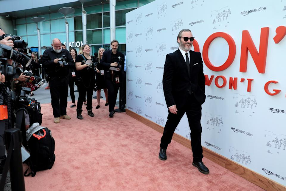 """Joaquin Phoenix poses at the premiere for the movie """"Don't Worry, He Won't Get Far On Foot"""" in Los Angeles, California, U.S., July 11, 2018. REUTERS/Monica Almeida"""