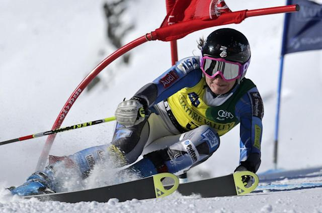 FILE - In this March 21, 2013 file photo Megan McJames, of Park City, Utah, snaps a gate during the first run of the women's giant slalom at the U.S. Alpine Ski Championships in Squaw Valley, Calif. Megan McJames isn't your typical member of the U.S. Ski Team's Olympic squad. For starters, she's not a member of the U.S. team. That's because McJames didn't meet the criteria to receive the team's financial support either this season or least. (AP Photo/Charles Krupa, File)