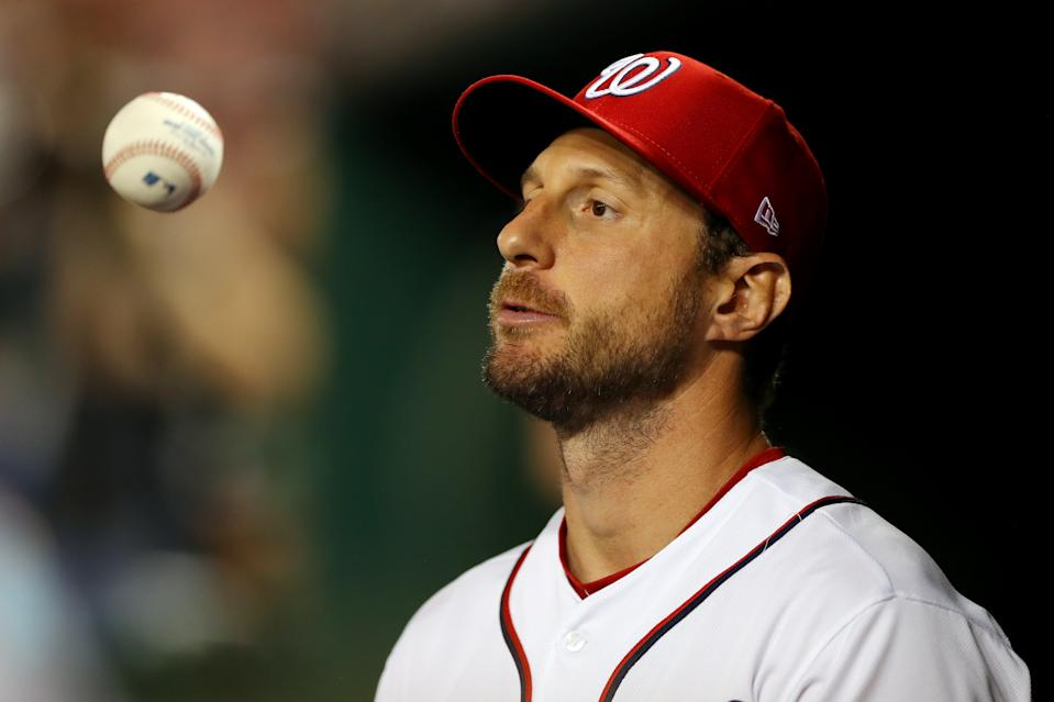WASHINGTON, DC - OCTOBER 06:  Max Scherzer #31 of the Washinton Nationals flips a ball in the dugout during Game 3 of the NLDS between the Los Angeles Dodgers and the Washington Nationals at Nationals Park on Sunday, October 6, 2019 in Washington, District of Columbia. (Photo by Alex Trautwig/MLB Photos via Getty Images)