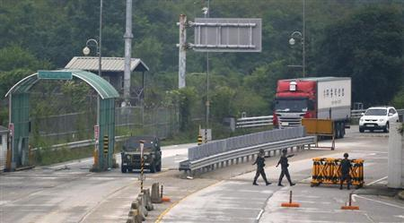 Soldiers man a checkpoint at the KIC at the South's CIQ in Paju