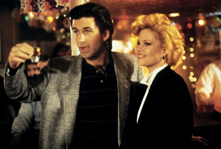 """Alec Baldwin (Mick) and Melanie Griffith (Tess) didn't hook up on the set of """"Working Girl"""" -- much to Griffith's disappointment. (Photo: Alamy)"""