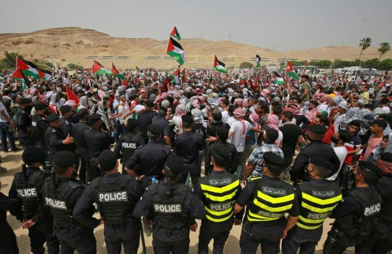 Rallies in solidarity with the Palestinians have been held in several countries; here Jordanian police surround protesters during a demonstration in Karameh