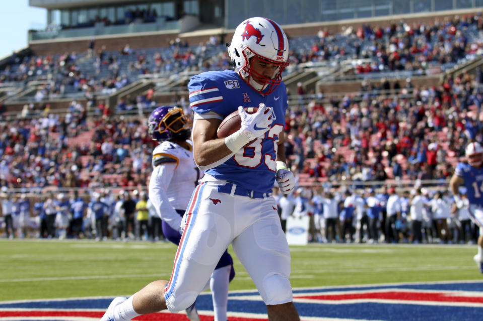 SMU tight end Kylen Granson scores a touchdown during the first half of an NCAA college football game against East Carolina, Saturday, Nov. 9, 2019, in Dallas. (AP Photo/Roger Steinman)