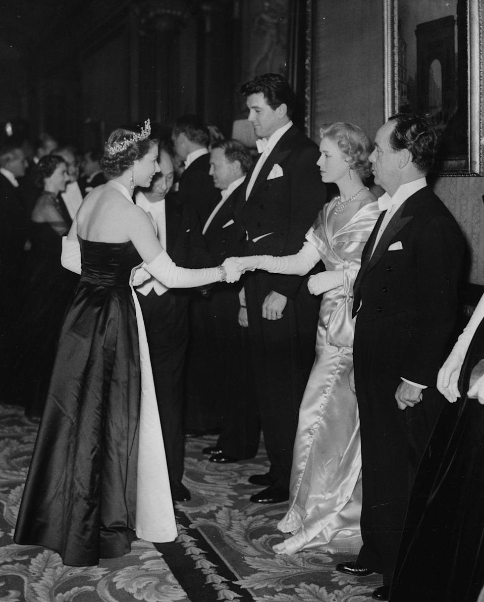 <p>Hudson and actress Veronica Hurst met a young Queen Elizabeth II at the Royal Film Performance in Leicester Square, London. </p>