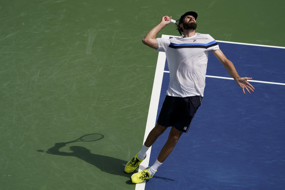 Reilly Opelka, of the United States, serves to Soonwoo Kwon, of South Korea, during the first round of the US Open tennis championships, Tuesday, Aug. 31, 2021, in New York. (AP Photo/John Minchillo)