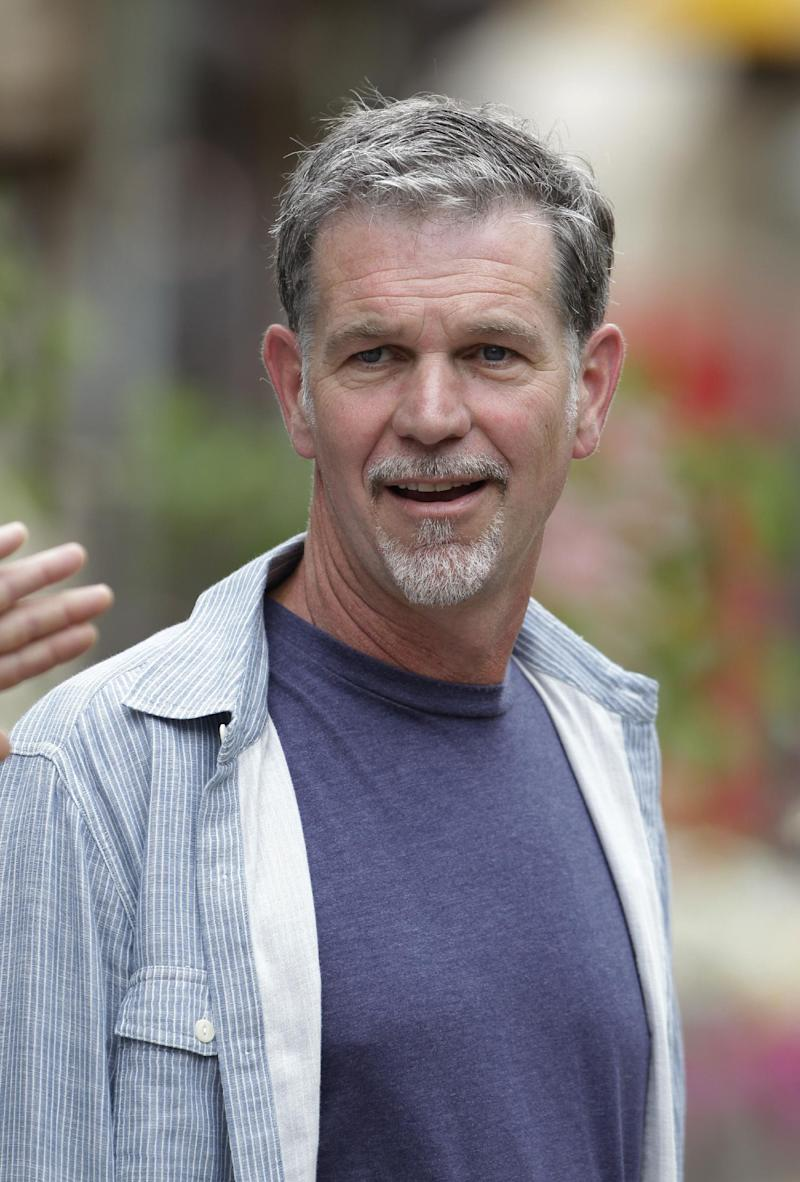 In this July 11, 2012 photo, Netflix CEO Reed Hastings at the Allen & Company Sun Valley Conference in Sun Valley, Idaho.  Netflix says its second-quarter earnings plunged 91 percent amid a slowdown in subscriber growth. The financial deterioration reported Tuesday follows a rare loss for Netflix during the opening three months of the year. In the latest quarter, Netflix Inc. added 1.1 million worldwide subscribers to its service that streams unlimited video over TVs and other Internet-connected devices for $8 per month. (AP Photo/Paul Sakuma)