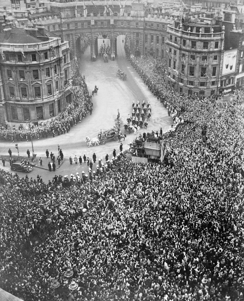 "Crowds gathered around <a href=""https://www.london.gov.uk/about-us/our-building-and-squares/trafalgar-square"" target=""_blank"">London's Trafalgar Square</a> to see Elizabeth and her father, King George VI, arrive at the service by royal coach."