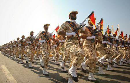 FILE PHOTO: Members of the Iranian revolutionary guard march during a parade to commemorate the anniversary of the Iran-Iraq war (1980-88), in Tehran