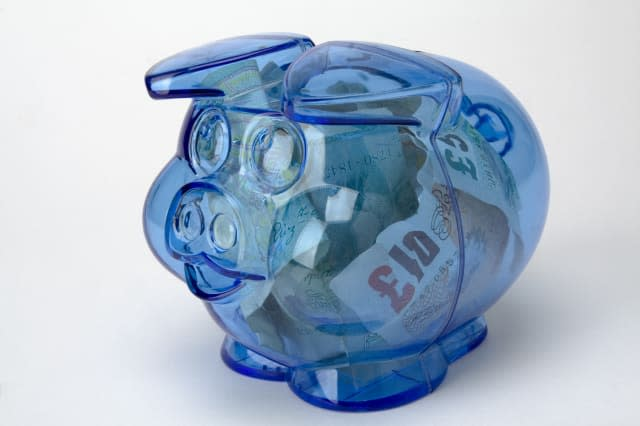 Piggy bank with pound notes money