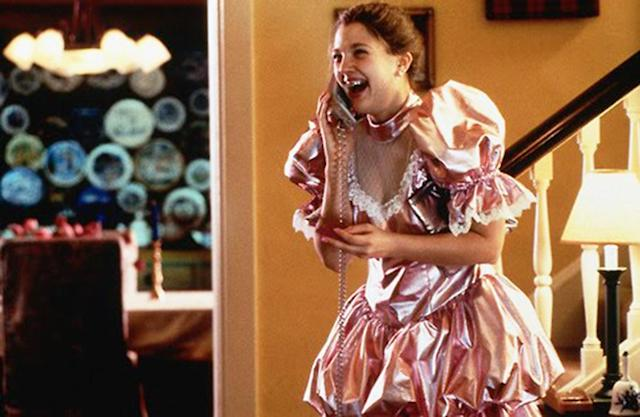 <p>Drew Barrymore in her flashback of her own high school prom, wearing a shiny pink, puffy-sleeved dress. How could we not include this one? (Photo: 20th Century Fox) </p>