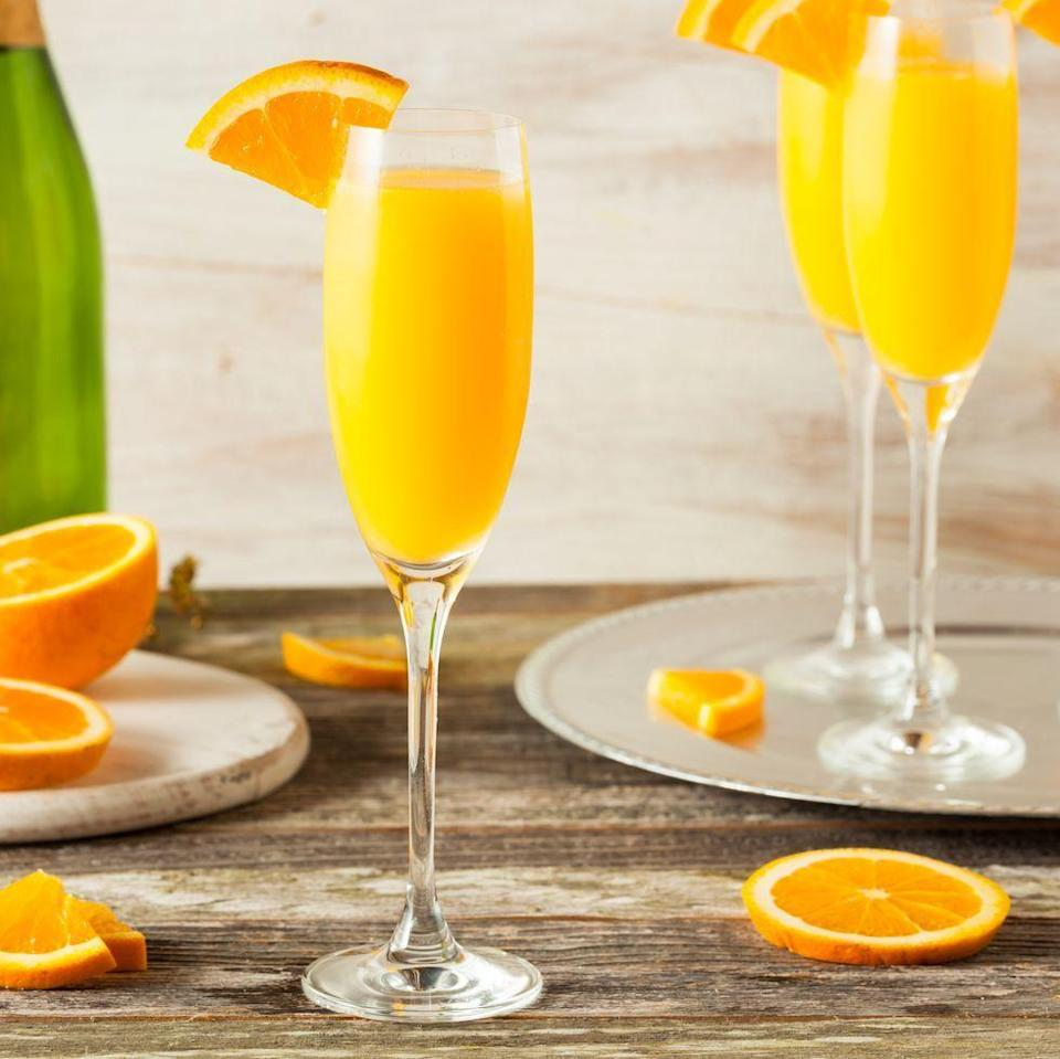 """<p>Containing just TWO ingredients, mimosas are the drink of choice for a girl's weekend get together, wedding reception toasts and the welcome lounge of a First Class flight (if you're ever lucky to score that upgrade). </p><p>Get the <a href=""""https://www.delish.com/uk/cocktails-drinks/a30924062/mimosa-cocktail/"""" rel=""""nofollow noopener"""" target=""""_blank"""" data-ylk=""""slk:Mimosa"""" class=""""link rapid-noclick-resp"""">Mimosa</a> recipe.</p>"""