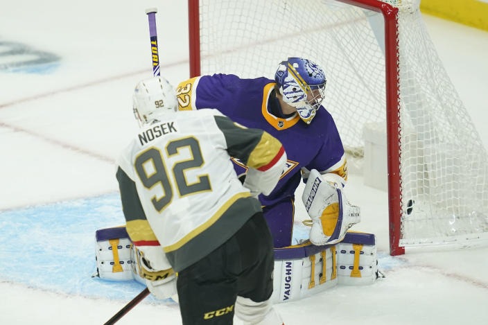 Vegas Golden Knights left wing Tomas Nosek (92) scores a goal against Los Angeles Kings goaltender Jonathan Quick (32) during the first period of an NHL hockey game Wednesday, April 14, 2021, in Los Angeles. (AP Photo/Ashley Landis)