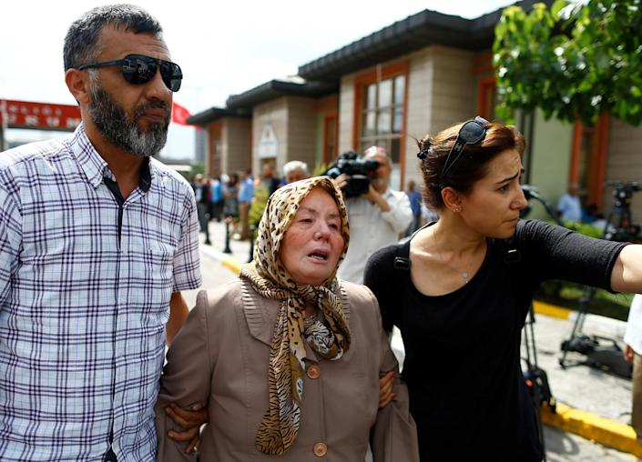 <p>Sacide Bugda, mother of Abdulhekim Bugda who was one of the victims of yesterday's blast at Istanbul Ataturk Airport, is comforted by her relatives as she walks to the front of a morgue in Istanbul, Turkey, June 29, 2016. (REUTERS/Osman Orsal) </p>