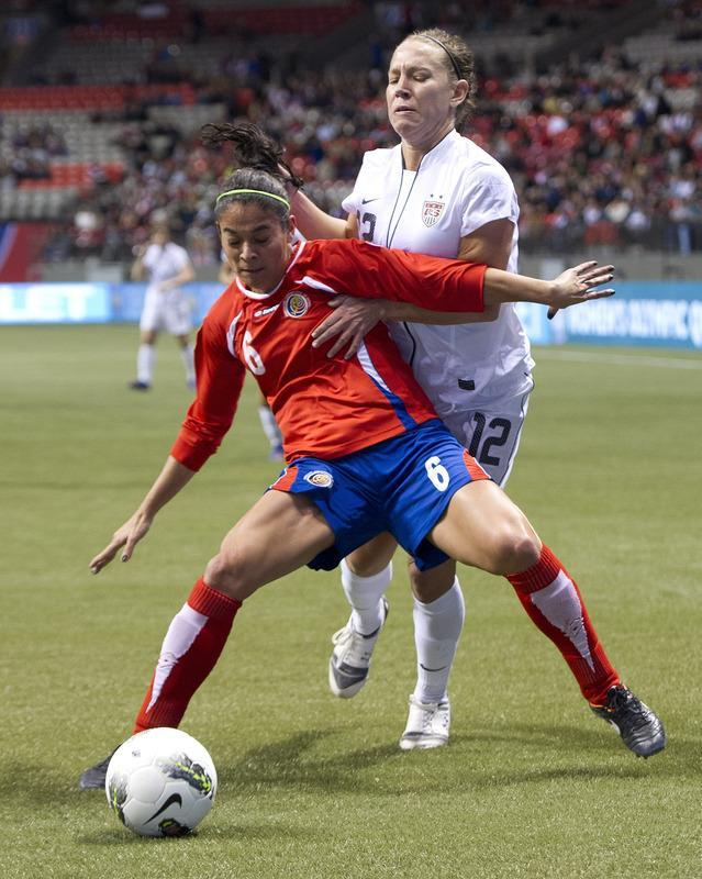 VANCOUVER, CANADA - JANUARY 27: Carol Sanchez #6 of Costa Rica shields the ball from Lauren Cheney #12 of the United States during the first half of semifinals action of the 2012 CONCACAF WomenÕs Olympic Qualifying Tournament at BC Place on January 27, 2012 in Vancouver, British Columbia, Canada. (Photo by Rich Lam/Getty Images)
