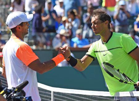 Mar 14, 2017; Indian Wells, CA, USA; Rafael Nadal (ESP) shakes hands with Fernando Verdasco (ESP) after defeating him his fourth round match in the BNP Paribas Open at the Indian Wells Tennis Garden. Mandatory Credit: Jayne Kamin-Oncea-USA TODAY Sports