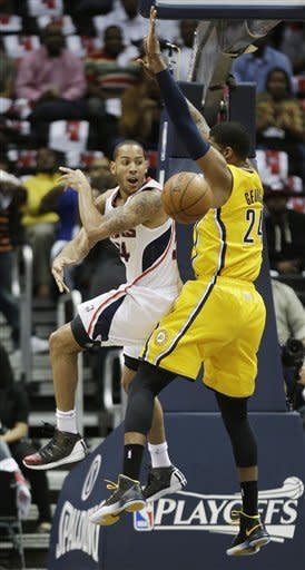 Atlanta Hawks point guard Devin Harris (34) passes the ball against Indiana Pacers small forward Paul George (24) in the first half of an NBA first-round playoff basketball game in Atlanta, Friday, May 3, 2013. (AP Photo/John Bazemore)