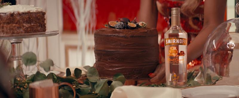 Smirnoff Kissed Caramel is playfully hidden in a fruitcake in Smirnoff's new holiday campaign.