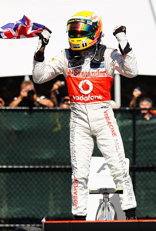 MONTREAL, CANADA - JUNE 10:  Lewis Hamilton of Great Britain and McLaren celebrates in parc ferme after winning the Canadian Formula One Grand Prix at the Circuit Gilles Villeneuve on June 10, 2012 in Montreal, Canada.  (Photo by Paul Gilham/Getty Images)