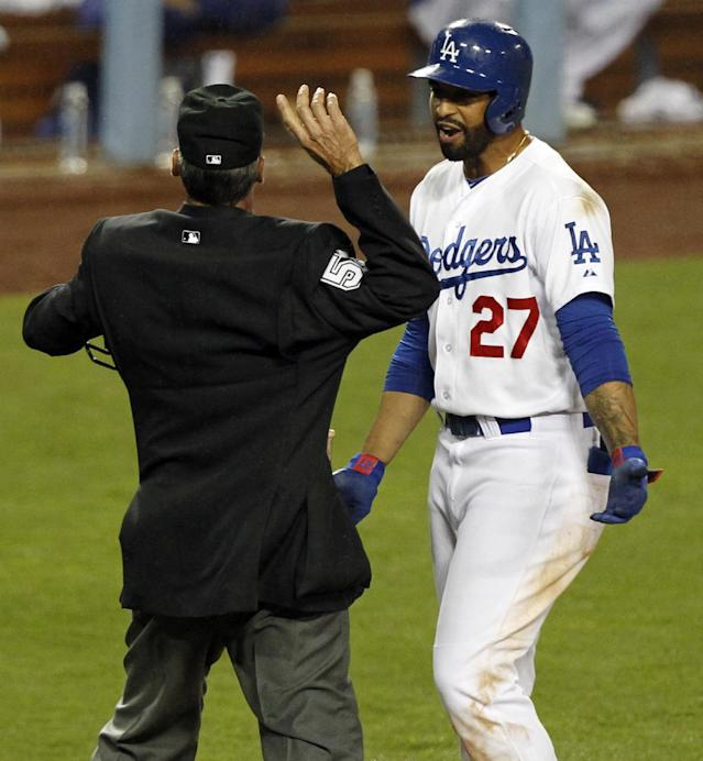 Home plate umpire Angel Hernandez, left, ejects Los Angeles Dodgers' Matt Kemp (27), after a third called strike, in the ninth inning of a baseball game against the Colorado Rockies on Friday, April 25, 2014, in Los Angeles. (AP Photo/Alex Gallardo)