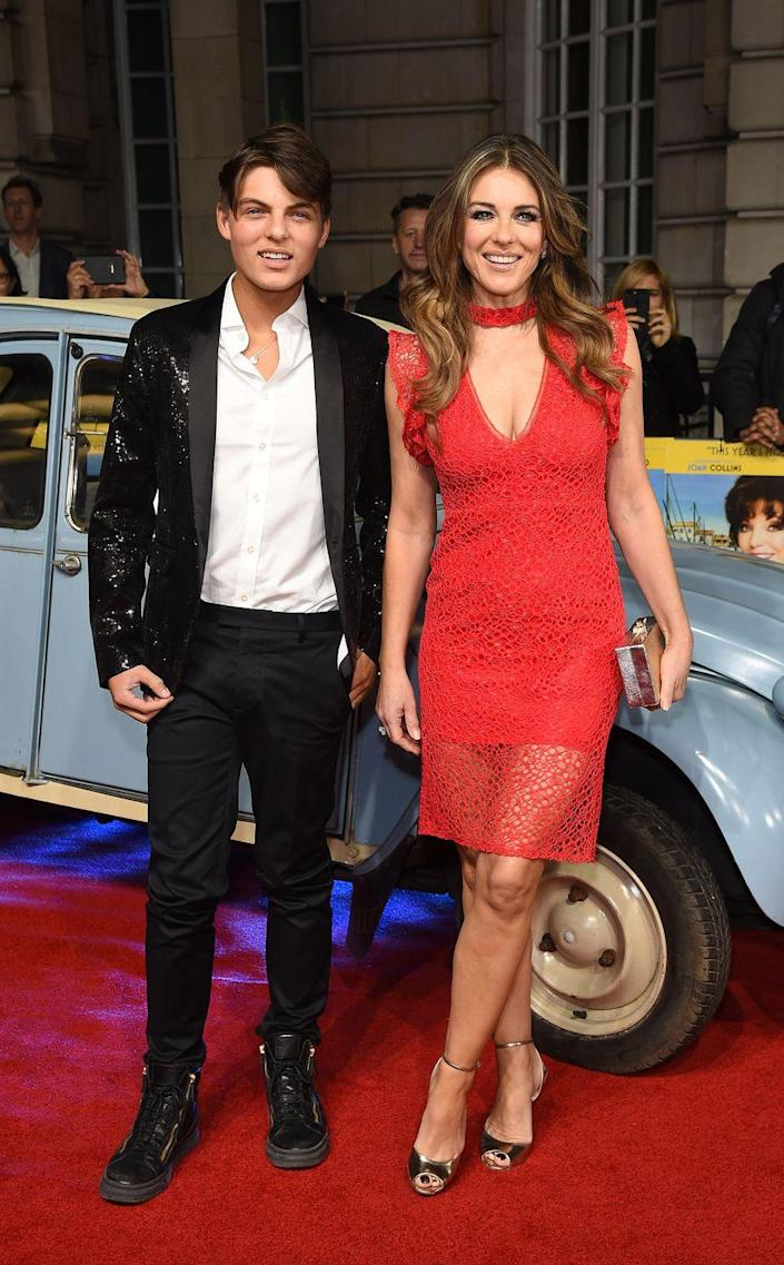 """<p>Here's Elizabeth and her 15-year-old son (at the time) on a red carpet together. Elizabeth enlists Damian's help to help capture her impressive <a href=""""https://www.womenshealthmag.com/fitness/a26721697/elizabeth-hurley-bikini-instagram/"""" rel=""""nofollow noopener"""" target=""""_blank"""" data-ylk=""""slk:bikini photos"""" class=""""link rapid-noclick-resp"""">bikini photos</a> for Instagram. Talk about a good son.</p>"""