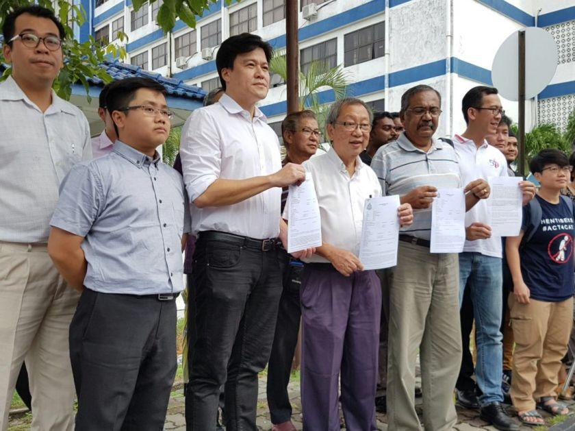 Bersih 2.0 Northern Peninsula Vice-chair Dr Toh Kin Woon (centre) and Hindraf's Ganesan lodged police reports at the Penang northeast district police headquarters here today. — Picture by Opalyn Mok