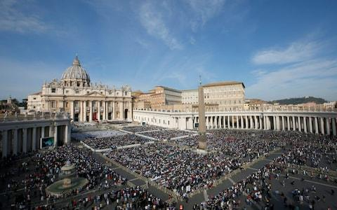 Crowds gather in the St. Peter's Square for Newman's canonisation - Credit: Reuters