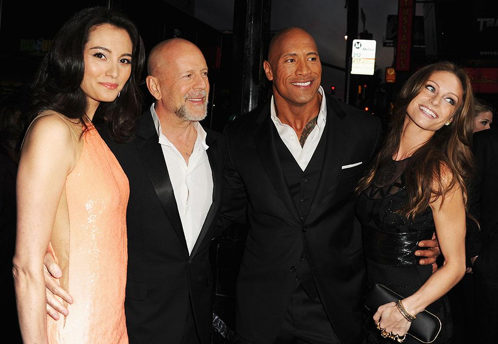 "mma Heming, actor Bruce Willis, Dwayne ?""The Rock""? Johnson and Lauren Hashian attend the premiere of Paramount Pictures' ""G.I. Joe:Retaliation"" at TCL Chinese Theatre on March 28, 2013 in Hollywood, California.  (Photo by Kevin Winter/Getty Images)"