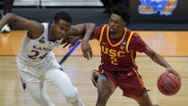 USC guard Tahj Eaddy (2) protects the ball from Kansas guard Bryce Thompson (24) during the first half of a men's college basketball game in the second round of the NCAA tournament at Hinkle Fieldhouse in Indianapolis, Monday, March 22, 2021. (AP Photo/Paul Sancya)