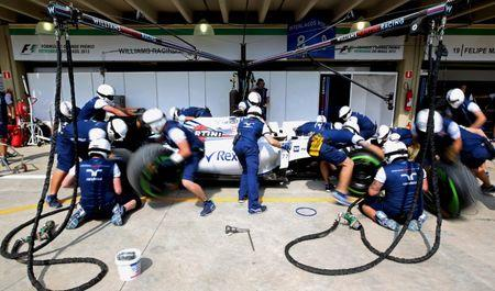 Members of Williams Formula One team practice pit stop ahead of the Brazilian F1 Grand Prix in Sao Paulo