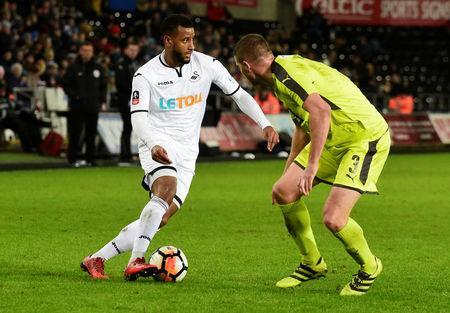 Soccer Football - FA Cup Fourth Round Replay - Swansea City vs Notts County - Liberty Stadium, Swansea, Britain - February 6, 2018 Swansea City's Luciano Narsingh in action with Notts County's Carl Dickinson REUTERS/Rebecca Naden