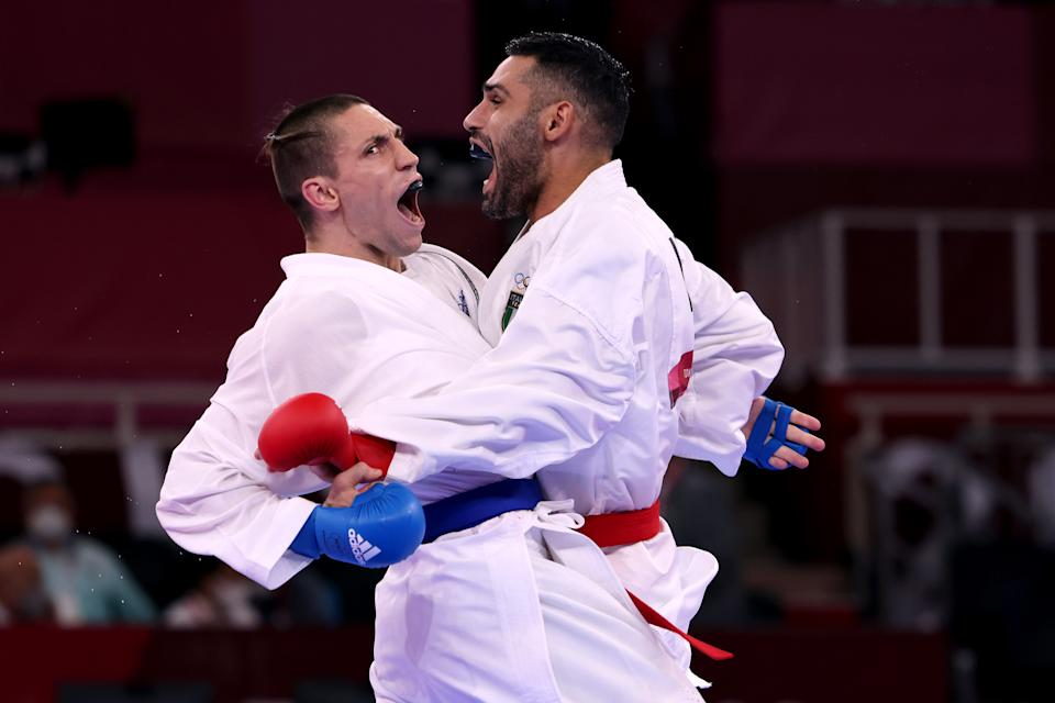 <p>Luigi Busa (R) of Team Italy competes against Stanislav Horuna of Team Ukraine during the Men's Karate Kumite -75kg Semifinal contest on day fourteen of the Tokyo 2020 Olympic Games at Nippon Budokan on August 06, 2021 in Tokyo, Japan. (Photo by Harry How/Getty Images)</p>