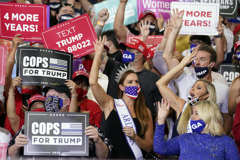 Supporters cheer as President Donald Trump speaks at a rally at Xtreme Manufacturing, Sunday, Sept. 13, 2020, in Henderson, Nev. (AP Photo/Andrew Harnik)